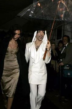 Prince escorting his 2nd former wife, Manuela Testolini, from the People's Choice Awards in the rain. Too cute!