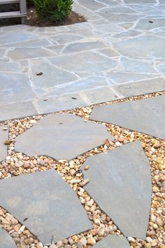 patio idea - love the stones with the baby stones...easy to do and zero up keep. perfect for the shady area at the bottom of the patio!
