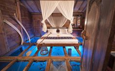 Bali's glass-bottomed hotel room- Set over a freshwater shrimp pond, Udang House (also known as the Shrimp House) at the Bambu Inda Hotel features a bedroom with glass floor panels that reveal a panorama of underwater activity.