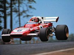 Clay Regazzoni taking his Ferrari 312B for a short flight at the 1971 German Grand Prix on the Nurburgring.  Regazzoni finished P3 in the race, behind the Tyrrell-Fords of winner Jackie Stewart and P2 François Cevert. #ScuderiaFerrari #RedSeason #Ferrari70