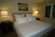 One Bedroom Lanai Suite – Features a separate living room with pullout sofa, and master bedroom with king bed.  The suite has a private patio that opens to the garden and pool.