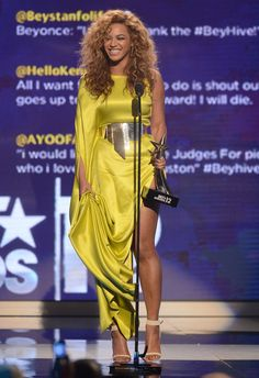 Yellow/ Gold is the colour of the season, Beyonce shows off her amazing legs in this Stephane Rolland Couture satin thigh-high split gown adorned with a hot metal belt.