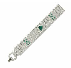 AN ART DECO EMERALD AND DIAMOND BRACELET The diamond-set openwork band with geometrical motifs, calibré-cut emerald detail, and centering upon triangular-cut emerald and diamond, mounted in platinum, 1920s