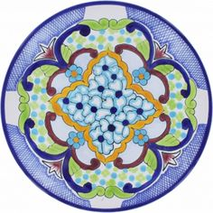 Decorative talavera plates are used for dining and decorating kitchen walls. A blue, green, yellow and white plate from Mexico is microwave safe. by Rustica House #myRustica