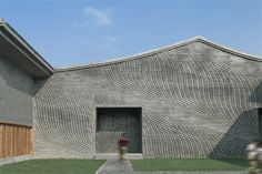 The Lanxi Curtilage / Archi Union Architects. Brick Screen