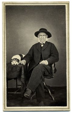 "https://flic.kr/p/a5Befr | Elderly Man With His Dog | <b><i>Carte de visite</i> by Loren Webster of Johnsburgh, N.Y.</b> A man sits in a chair with his right arm resting on a cloth-covered table on which is seated a dog. The dog is asleep, head resting on paws.  <i>I encourage you to use this image. However, please <a href=""mailto:rcoddington@facesofwar.com"" rel=""nofollow"">ask for permission</a>.</i>"