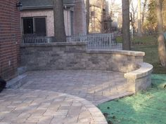 Paver patio with stepped seat wall custom designed and built by Archadeck of Chicagoland.