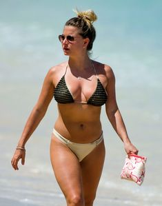 Zara Holland in Black Bikini on Holiday in Barbados