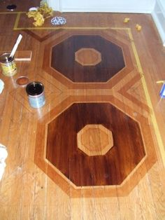 How to Create Faux Marquetry - tips on staining a floor design without the stain bleeding.