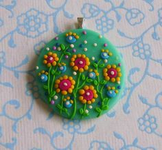 Fimo Polymer Clay Necklace Medallion - flowers in the green garden via Etsy