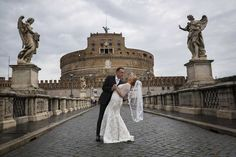 Dipping the bride on the Castel Sant'Angelo bridge. Image by Andrea Matone #wedding photographer.