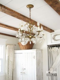 She found this stunning chandelier on eBay for about $80, and what a difference it makes in the airy, light room.