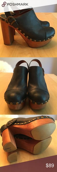 Jeffrey Campbell Black Woodies Clogs, Size 40 Black leather with brass studs and wooden soles...perfect vintage look for this fall! Strap can be worn on heel, across top of shoe, or slid down over the heel (see photos). Size 40 will fit 9 to 9.5 US. Very good condition. Comes from non-smoking home. Jeffrey Campbell Shoes Mules & Clogs