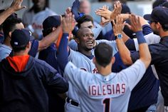 High-fives all around:    Justin Upton of the Detroit Tigers, center, celebrates with teammates in the dugout after hitting a three-run home run during the 11th inning against the Chicago White Sox at U.S. Cellular Field in Chicago on Sept. 5. The Tigers won 5-3.