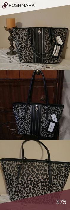 Leopard Print Shoulder Bag From Nine West here is a Beautiful Leopard Print Bag. Black and Silver Zipper Accents adorn the front. Inside you find three large Compartments. Two outside compartments have a zipper pocket and two slip pockets. The center will Zip closed. This bag is New with tags attached. Nine West Bags Shoulder Bags