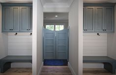 Modern Farmhouse Mudroom / Laundry Room With Blue Cabinets White Shiplap Walls
