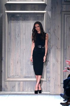 Designer Victoria Beckham appears on the runway at the Victoria Beckham fall 2012 fashion show during Mercedes-Benz Fashion Week at New York Public Library - Astor Hall on February 12, 2012 in New York City.