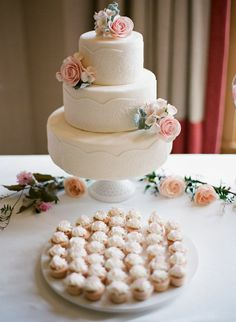 White wedding cake with lacy details and keepsake blooms made out of clay | Photo by Austin Warnock