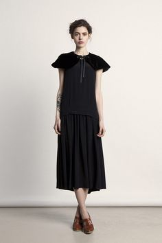 I love the little velvet capelet collar. From Colenimo A/W 2012.