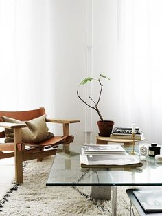 Scandinavian-inspired living room with a large white shag rug and a modern leather chair
