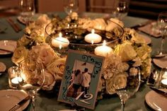 Wedding Reception Centerpiece Idea: The picture frame is what I want to do for my table numbers! I like the idea of a wreath around a bowl with floating candles
