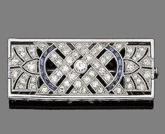 A sapphire and diamond brooch, circa 1920.  The rectangular openwork plaque of geometric design, millegrain-set throughout with old brilliant and single-cut diamonds, highlighted with calibré-cut sapphires, diamonds approx. 2.55cts total, length 4.5cm
