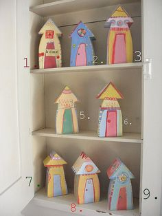 wooden houses by sarah ahearn. Love the shapes and colors!