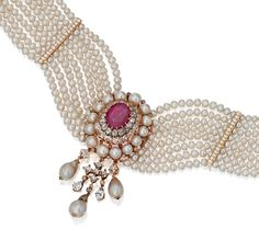 GOLD, NATURAL PEARL, DIAMOND & RUBY CHOKER NECKLACE. Set at the center with an 10.78 ct oval ruby framed by 14 natural pearls & old mine, rose-cut & old European-cut diamonds, supporting three pendants set with old mine & old European-cut diamonds & 3 pearl drops, completed by an eight strand necklace composed of natural pearls spaced by gold bars set with round diamonds, length 12¾ inches.