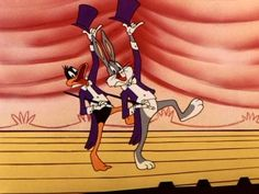 """Daffy Duck and Bugs Bunny dance together before throwing it down in """"Show Biz Bugs."""""""