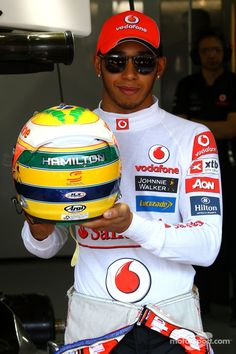 Lewis Hamilton with tribute helmet to Ayrton Senna