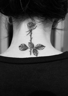 rose thorn tattoo. back of neck.