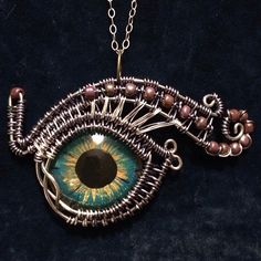 Evil eye. Hand painted cast resin eye, wrapped in copper wire.