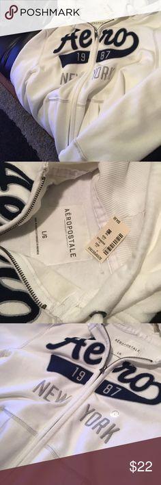 Aeropostale zip hoodie large- NWT Aeropostale zip hoodie large- NWT. White/cream in color with navy and gray writing. Very nice! Aeropostale Jackets & Coats Lightweight & Shirt Jackets