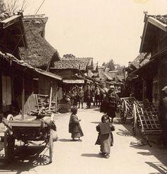 Rustic road through a rural town, ca. 1895-1898 by T. Enami