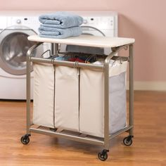 Seville Classics 3-Bag Laundry Sorter w/Folding Table  (I have a similar sorter but without the fold down top, which would really be useful.  Pretty sure my husband could fabricate the top... honey, are you listening?)