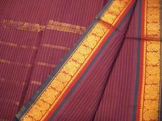 The Madurai saris are woven out of very shiny, highly mercerized cotton with glistening silk borders, which used to be made of silk, but are now mostly polyester or shiny cotton. Madurai saris are airy and lightweight, perfect for the very hot climate. India Wedding, Saree Border, Madurai, Mysore, Saree Styles, Cotton Saree, Indian Sarees, Stripe Print, Beautiful Dresses