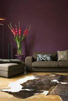 Deep purple. Everything but the rug in this room is stunning. I would love it if my living room was like this.
