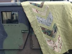 military quilt | Quilt Story... love this, using bits of old uniforms.