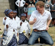 Prince Harry swayed to the beat while visiting a school for deaf children in South Africa