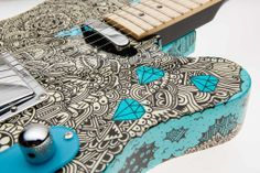 Cool tattooesqe graffiti design - from Moniker Custom Guitars