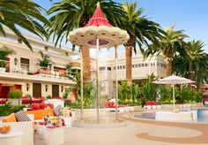 Encore Beach Club patrons lounge on oversize lily pads and dance under shower poles - and those who splurge enjoy private bungalows overlooking the Strip.