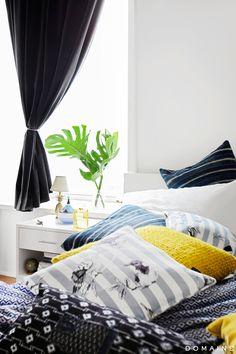 Dark curtains against white walls in Harley Viera-Newton's SoHo apartment