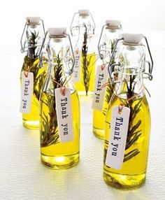 Italian themed wedding - Favour Idea.  Rosemary springs with olive oil in little bottles.  Inexpensive, personal and definitely Italian!