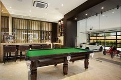 Garage Man Cave Designs Create The Beauty Of Your House: Modern Man Cave Garage Designs With Glass Doors And Wine Cellar ~ lanewstalk.com Home decor Inspiration