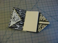 """Miniature version of the Diagonal Pocket Folder created by Hedi Kyle in the book """"Playing With Paper"""" by Helen Hiebert"""