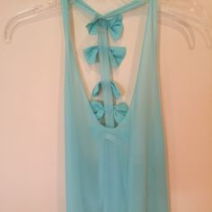 Light blue Millau sheer blouse Sheer light blue blouse with four bows lined on the back. Millau Tops Tank Tops
