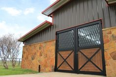 These custom-made, aluminum, doors really dress up this horse barn! They were faux-wood painted to last longer and be lower maintenance than real wood. Modern Ranch, Modern Farmhouse Style, Modern Rustic, Faux Wood Paint, Aluminium Gates, Security Gates, Iron Gate Design, Custom Gates, Texas Ranch