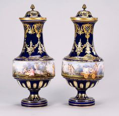 A pair of Sevres-style vases and covers late 19th century the drum-shaped bodies charmingly painted with continuous scenes of scantily clad classical figures in an idealised rural landscape, the deep blue spreading feet and tall trumpet necks with gilded and jewelled borders, the covers with gilt metal knops, 44.5cm, pseudo Sevres marks (slight wear to gilding, a few jewels missing, slight oxidisation to the blue enamel) (4)