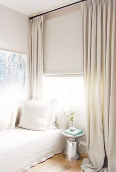 Neutral curtains in white bedroom
