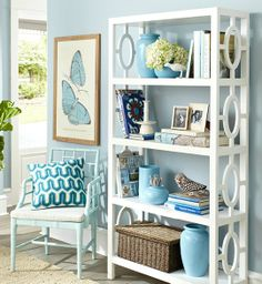 This Blue-Entryway from Wisteria home furnishings, is a calm and inviting space.